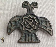Mongolian cross and swastika with the cross taking the form of the double-headed eagle, a heraldic symbol going as far back as the Hittites of 1900 BC.  The swastika is enclosed in an 8-rayed star probably representing Venus/Mary.