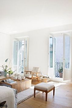 French doors, wooden coffee table and textured white rug, mid-century arm chair
