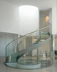 Professionals in staircase design, construction and stairs installation. In addition EeStairs offers design services on stairs and balustrades.Check out our work >> Spiral Staircase Outdoor, Curved Staircase, Spiral Staircases, Staircase Ideas, Winding Staircase, Interior Staircase, Metal Stair Railing, Stair Railing Design, Staircase Contemporary