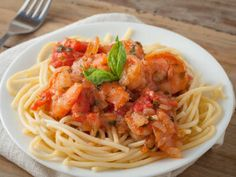 This delicious pasta dish is filled with fresh shrimp and tomatoes. You can serve it hot or eat it the next day as a cold pasta salad.