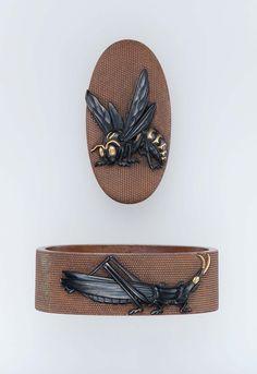 Fuchi-kashira with designs of wasp, butterfly and grasshopper. Japanese Edo period–Meiji era mid to late 19th century - Kanaya Gorosaburo IX, Shoami School http://www.mfa.org/collections/object/fuchi-kashira-with-designs-of-wasp-butterfly-and-grasshopper-12410