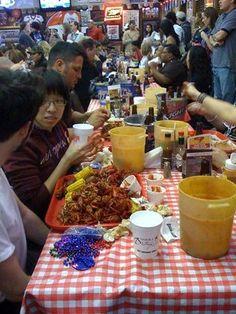 Buckets of crawfish & beer at the Ragin Cajun restaurant in Houston
