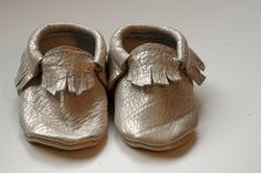 Gold baby moccasins! Also come in metallic pink and basic brown. I'll take a pair for the baby and a pair for me.