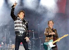 Stylish: During the show Mick unzipped his jacket to reveal a black and grey striped shirt underneat. - Provided by Associated Newspapers Limited Ronnie Wood, Mick Jagger Wife, Melanie Hamrick, Spitting Image, Operation, Two Year Olds, Grey Stripes, Rolling Stones, Surgery