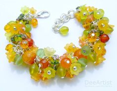 """""""Lime & Tangerine"""" bracelet Made of 105+ beads: semiprecious gemstones (lemon jade, green marble, carnelian, faceted agate), lucite flowers, artisan lamp work (artist unknown), crystal glass beads, matte glass + silver plated lobster clasp, jump rings and wire."""