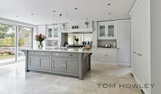 this contemporary grey kitchen is packed with appliances and features that are b… - luxury kitchen Open Plan Kitchen Living Room, Home Decor Kitchen, Kitchen Interior, Space Kitchen, Family Kitchen, Grey Kitchens, Luxury Kitchens, Home Kitchens, Küchen In U Form