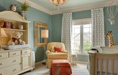 blue-green nursery, cream upholstered chair, burnt orange ottoman, plush giraffe (Benjamin Moore, Brandy Cream)