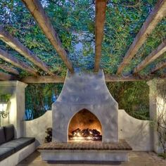 "Cosy and cute outdoor fireplace and seating area with canopy. Makes a nice change from the original ""fire pit""."