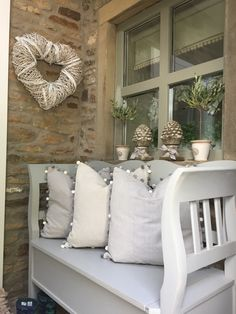 Beautiful pom pom cushions in this modern country home. For more interior design inspiration, head on over to our website, www.thehomedesignschool.com and learn how to make your home as gorgeous as this one!