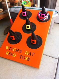 Witch's hat ring toss! Perfect for a neighborhood or trunk or treat party this Halloween!