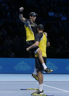 Mike Bryan of United States, left, and Bob Bryan of United States celebrate their win against Alexander Peya of Austria and Bruno Soares of Brazil at the end of their ATP World Tour Finals double semifinal tennis match at the O2 Arena in London Sunday, Nov. 10, 2013. (AP)