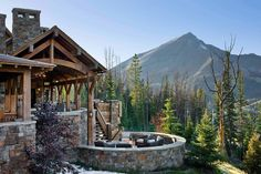 Summit Residence is a sensational rustic mountain retreat designed by Locati Architects, located in the prestigious ski resort community of Yellowstone Club, Big Sky, Montana. Small Fire Pit, Modern Fire Pit, Rustic Patio, Rustic Outdoor, Yellowstone Club, Rustic Houses Exterior, Porches, Covered Patio Design, Covered Patios