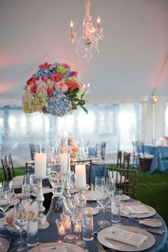 Chandeliers in tents is such a great look!