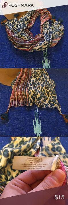 Ann Taylor Loft leopard print scarf Ann Taylor Loft leopard print and striped scarf. Worn a few times, excellent condition. Has super cute tassels on ends. LOFT Accessories Scarves & Wraps