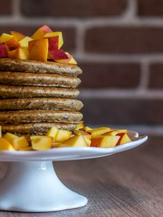 Vegan pancakes with peaches and maple syrup