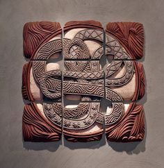 Infinity Squared by Christopher Gryder. Ceramic relief wall tiles formed by carving a dissolvable mold from silt, casting clay within, and excavating several days later. Glazed and fired with colored terra sigillata. Suitable for either interior or exterior installation. The assemblage is comprised of 9 tiles. Each tile (8in x 8in x 1.5in) can be hung on the wall with a simple hook or nail, similar to that used for hanging framed artwork.