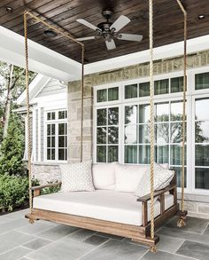Glorious farmhouse porch bed swing with a fabulous dark wood slat ceiling. Backyard Swings, Pergola Swing, Gazebo, Backyard Ideas, Porch Bed Swings, Pergola Kits, Swinging Porch Bed, Outdoor Bed Swings, Porch Bed Swing Plans