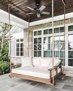 Glorious farmhouse porch bed swing with a fabulous dark wood slat ceiling. Backyard Swings, Pergola Swing, Gazebo, Backyard Ideas, Porch Bed Swings, Pergola Kits, Swinging Porch Bed, Porch With Swing, Outdoor Bed Swings