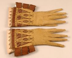 The Worshipful Company of Glovers of London - The Glove Collection and its Catalogue - buff kid gloves. These gauntlets have deep crimson triangle and oval satin appliques, over embroidered with gold thread. 17th Century Fashion, Gauntlet Gloves, Renaissance, Historical Clothing, Historical Art, Historical Costume, Vintage Gloves, Kerchief, Bobbin Lace