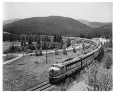 """The famous """"California Zephyr"""" roll through Colorado on Denver and Rio Grande Western Rails, circa 1960. This modern Domeliner traveled a route of 2,532 miles from Chicago to Dan Francisco. The luxury train was jointly operated by the Burlington, Rio Grande and Western Pacific Railroads."""