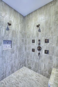 Enjoy your private little spa- body sprays, multiple shower heads and gorgeous tile surround #moen #gnw homes
