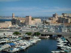 Marseille: Old port (Vieux-Port) with its boats, Saint-Jean fort and his towers in background - France-Voyage.com