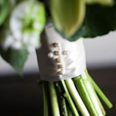 Cross bouquet pins Inquire@riveroakscharleston.com Hunter McRae photography  Florals by Jennigray Hewitt @ RiverOaks