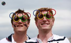 Men pose for a photograph wearing their Olympic sunglasses in the Olympic Park in Stratford, east London during the London 2012 Olympic Games. OLIVIA HARRIS/REUTERS