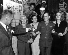 (l To R) Lana Turner, Deanna Durbin, And Marlene Dietrich Greet Sgt. Carl Bell As The Milliionth Man To Visit The Hollywood Canteen