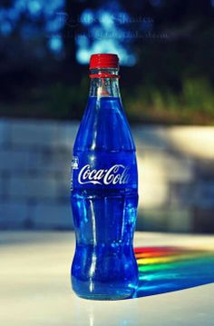 Blue coca—cola...love the rainbow reflection behind the bottle.  So awesome!!