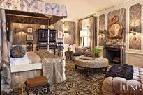 Martyn Lawrence Bullard designed this master bedroom to reflect the tastes of Mr. Doheny, Greystone's late owner. Touches include Indian paisley covered walls, an exotic mother-of-pearl Syrian mirror and 18th-century Italian ivory-inlaid curio cabinets.