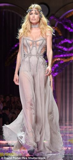 Fairy queens: Doutzen Kroes (left) and Karlie Kloss (right) sported beautiful, billowing purple gowns as they conquered the catwalk