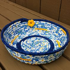 Fabric Coiled Basket / Bowl in White and Blue with touches of Yellow, accented with a Yellow Flower Button. $14.00, via Etsy.