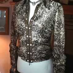 Zip front blouse or jacket NWOT Sassy zip up top piece in brown animal theme. Slightly sheer sleeves gathered at wrists and bodice Alberto Makali Tops Blouses