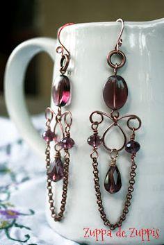 """""""Ellisse""""; orecchini chandelier artigianali interamente realizzati a mano in rame forgiato a freddo con perle di vetro pressato e cristalli swarovski color vino"""