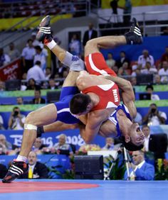 Italy\'s Andrea Minguzzi, bottom, wrestles Hungary\'s Zoltan Fodor in the final of the men\'s 84kg Greco-Roman wrestling at the 2008 Olympics in Beijing, Thursday, Aug. 14, 2008. Minguzzi won the gold medal.