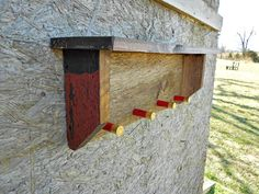 Rustic Barn Wood Shelf with 12 Gauge Shotgun Shell Hangers. $42.00, via Etsy.
