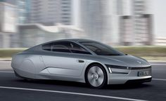 "2011 Volkswagen XL1 Concept -   Volkswagen XL1 Concept First Drive  Review  Car and Driver  Volkswagen 1-litre car  wikipedia  free encyclopedia The xl1 is the third iteration of the volkswagen 1-litre car unveiled at the 2011 qatar motor show. the diesel plug-in hybrid prototype is branded as a ""super. Volkswagen xl1 concept  aw flash drive 