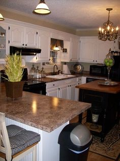 Painted Black and White kitchen - I have the same formica countertops with maple cabinets. I want a white/black painted cabinet combo, but thought I couldn't do it until we could get new countertops. This space has prooved me wrong!