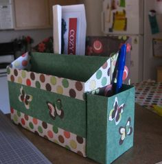 Stationary Organizer made from cereal boxes and scrapbook paper...I added a pen holder (spaghetti box). see the tute at katydidandkid.com