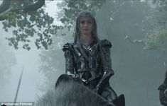 Emily Blunt as the Ice Queen, riding a polar bear into battle in The Huntsman Winter's War. Her shimmery, scaled, silver armor is stunning. The character has the look of the White Witch from Narnia at least riding the bear. From Daily Mail.