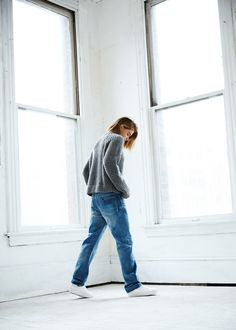 Loose jumper, trainers and jeans