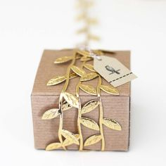 This gold leaf ribbon is such a cute decoration for a #wedding favor box! Ribbon by Caramelos Artful Supplies http://etsy.com/listing/81607022/10-yard-roll-of-gold-leaf-ribbongarland Photo Credit: Caramelos Artful Supplies http://etsy.com/shop/caramelos