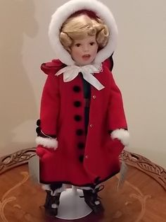 Little Caroler from the series The Shirley Temple Christmas Doll Collection - from the Danbury Mint. Designed by the world-renowned doll artist Elke Hutchens. The head, arms and legs are crafted of fi