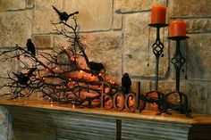 DIY Halloween mantel decorations. Super easy! Just spray paint a broken off tree limb black and glue faux blackbirds in it. Add small lights to branches.