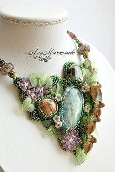 Bead embroidery by Alla Maslennikova. I love the whimsy of the three dimensional elements...