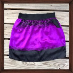 Glam Black and Purple Splatter Skirt Features elastic waist and side pockets. The satin textured skirt has a black and purple splatter like pattern with sprinkles of white on the hem. Worn only once and in great condition. Glam Skirts Mini