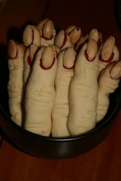 "Halloween- ""finger"" cookies!  Sugar cookies with red icing and an almond for a finger nail....kinda grosssssss, but a cool idea"