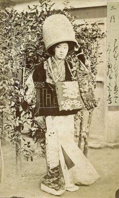 Twelve Transfigurations of a Geisha - 1870s | February 二月 nigatsu, month of changing clothes. Meigi (famous geisha) Era Kayo dressed as a Komusō Buddhist monk.