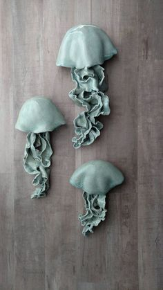 Jellyfish wall hanging sculpture. Light blue. Beach house decor, nautical bathroom, yacht art. https://www.etsy.com/listing/494569134/jellyfish-ceramic-wall-sculpture-set-of